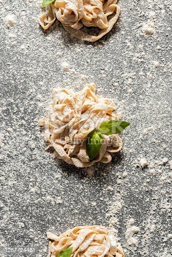 Fresh organic vegan pasta made at home over dark background