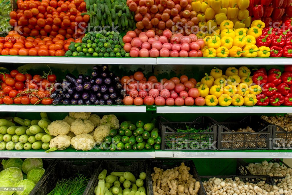 Fresh organic Vegetables and fruits on shelf in supermarket, farmers market. Healthy food concept. Vitamins and minerals. Tomatoes, capsicum, cucumbers, mushrooms, zucchini, stock photo