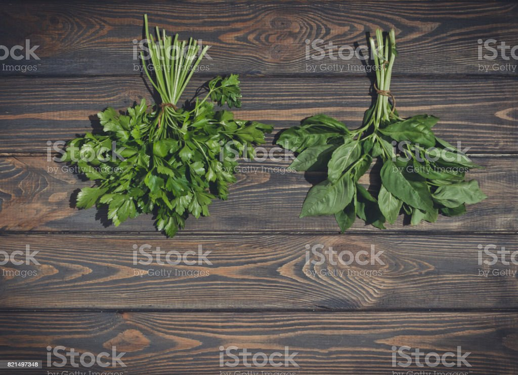 Picturesque fresh greenery. Basil, squash and other green vegetables....