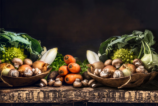 istock Fresh organic vegetables from garden on old rustic wooden table 479883888