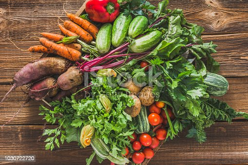 istock Fresh organic vegetables harvest. Local farmer market with vegetable box on wooden background, vegetarian food concept 1030722720
