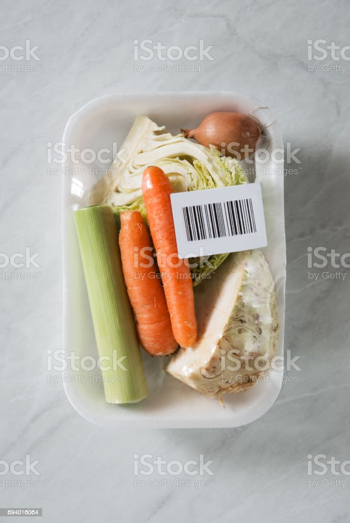 Fresh organic vegetables inside of package with bar code label stock photo