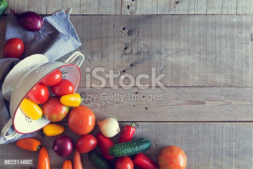 istock Fresh organic vegetables on a wooden background. Top view 882314692