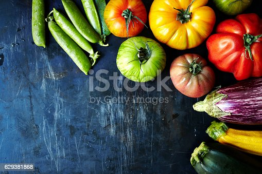 Fresh organic vegetables on dark metal surface