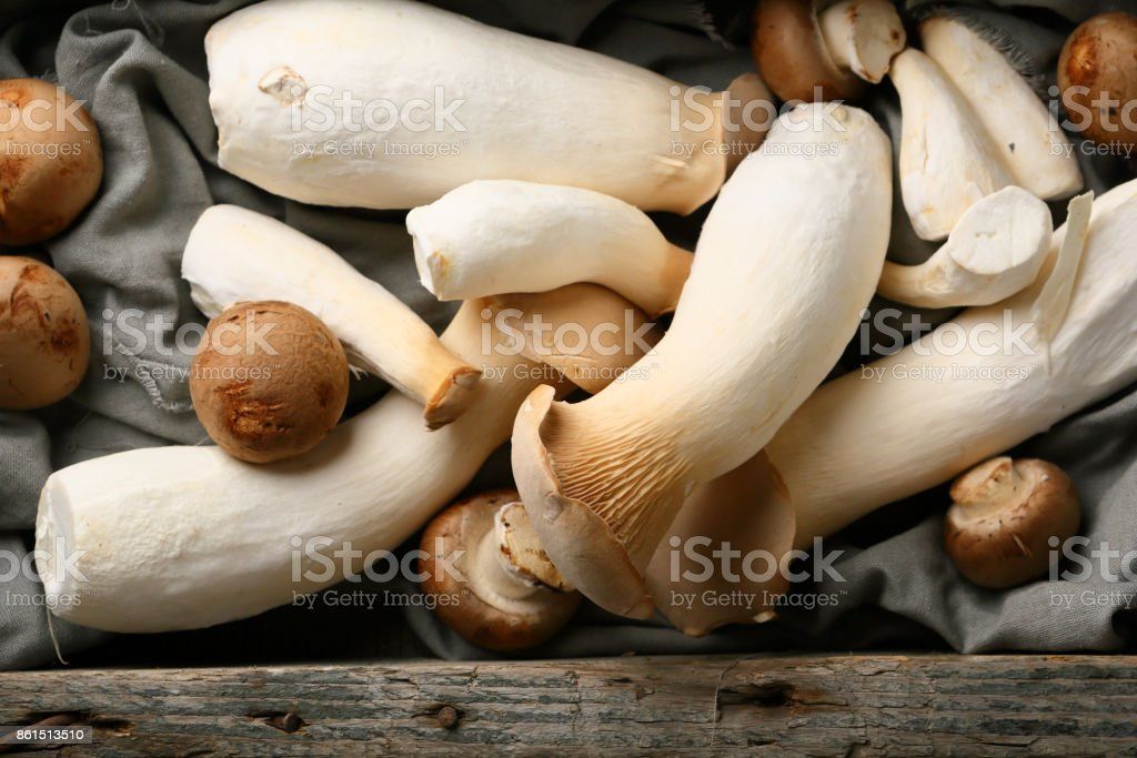 Fresh oyster mushrooms in wood crate, food above stock photo