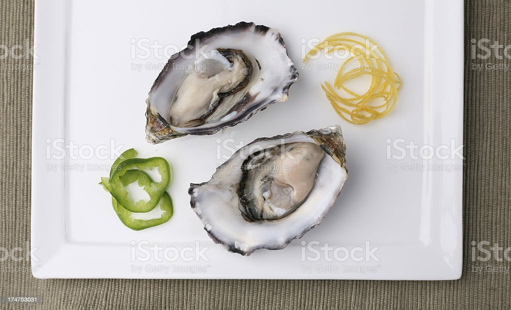 Fresh Oysters on plate top down stock photo