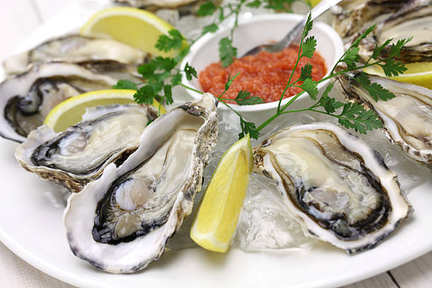 fresh oysters plate - animal shell stock pictures, royalty-free photos & images