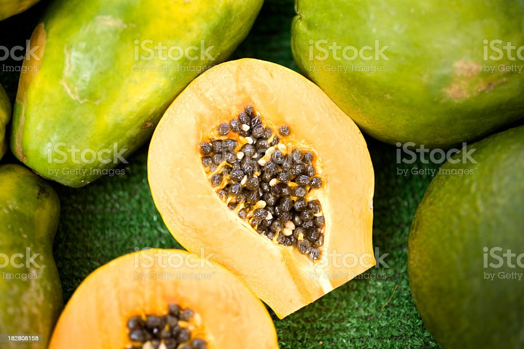 Fresh papaya cut in half with seeds inside stock photo