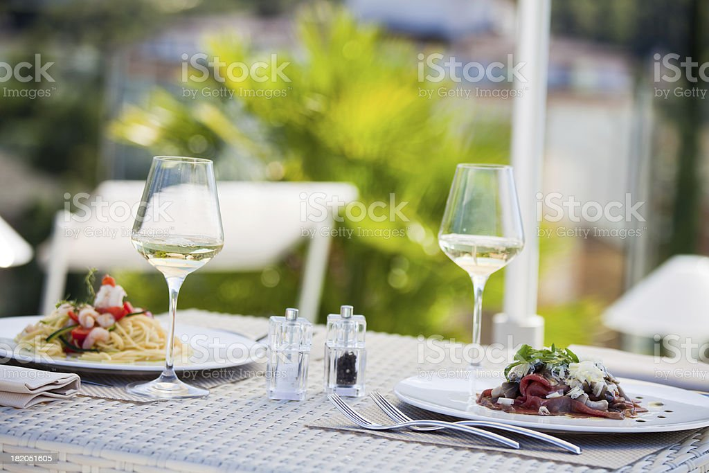 Fresh Pasta and Meat in Restaurant at Summer stock photo