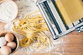 istock fresh pasta and pasta machine 607271928