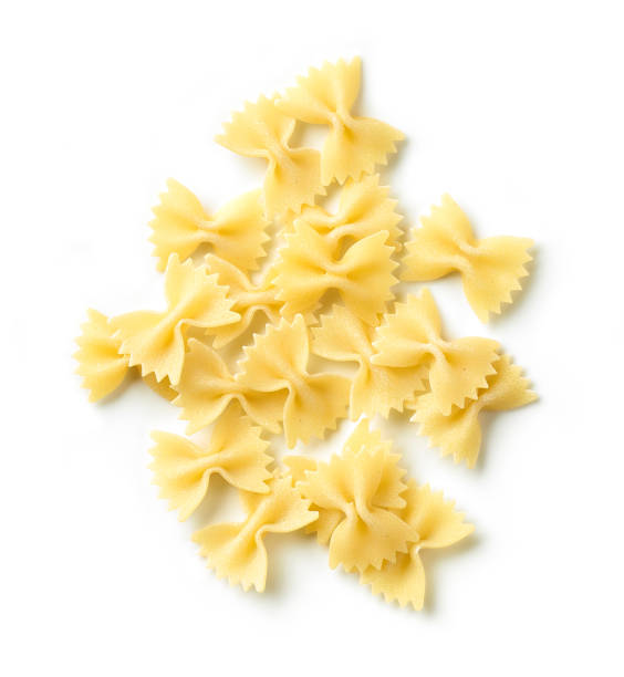 fresh pasta Farfalle fresh pasta Farfalle isolated on white background, top view bow tie pasta stock pictures, royalty-free photos & images