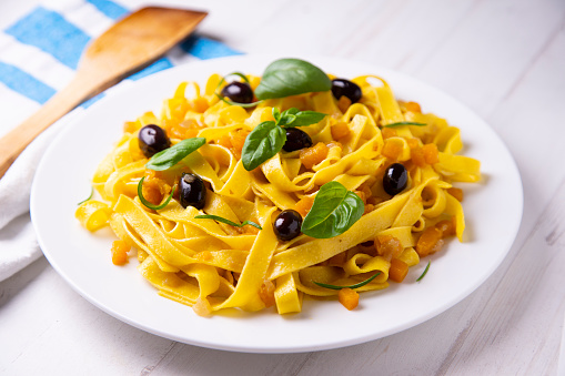 Fresh pasta with olives and pumpkin