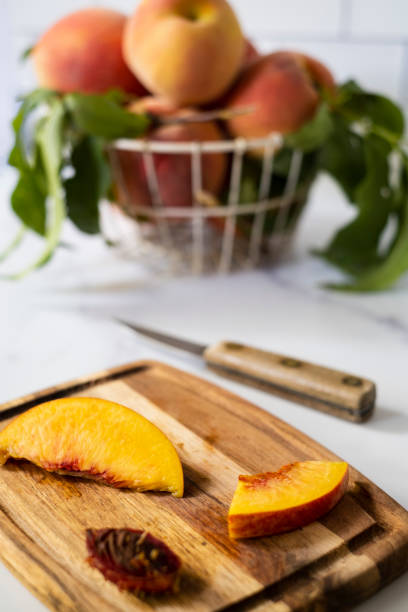 Fresh Peach Cut on a Cutting Board stock photo