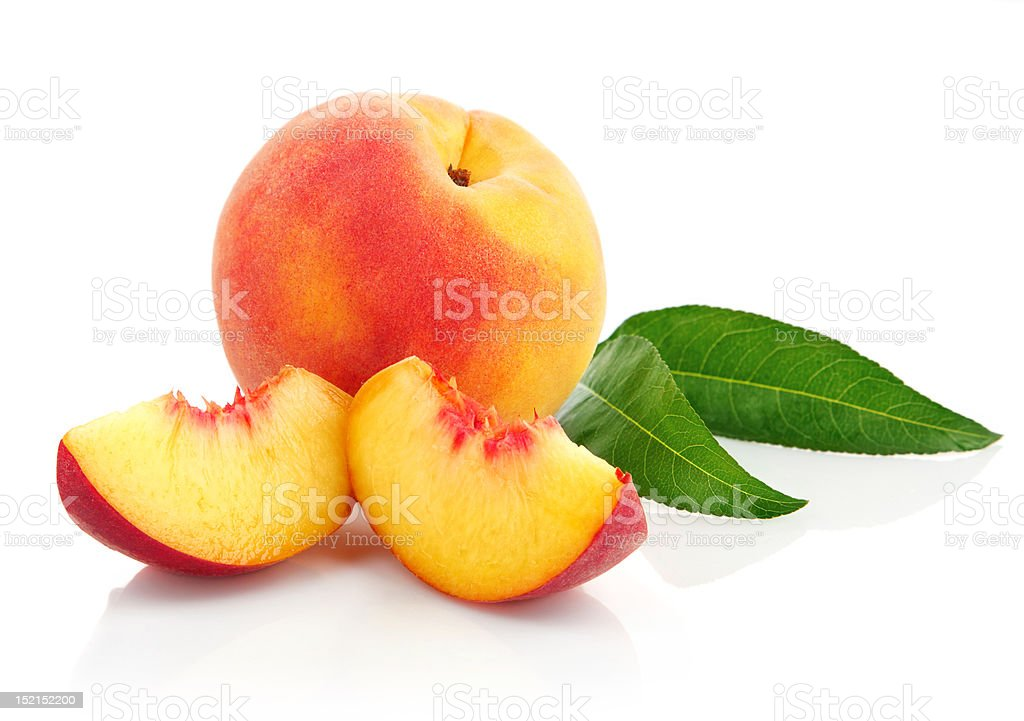 fresh peach fruits with green leaves stock photo