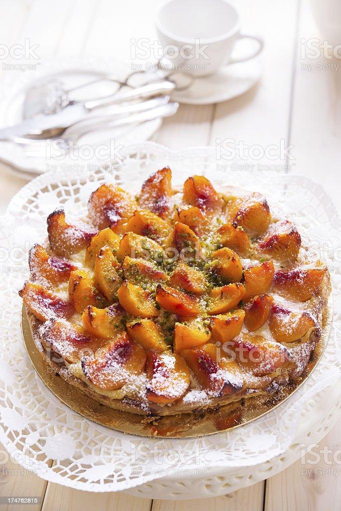 Fresh Peach Tart With Chopped Pistachio royalty-free stock photo