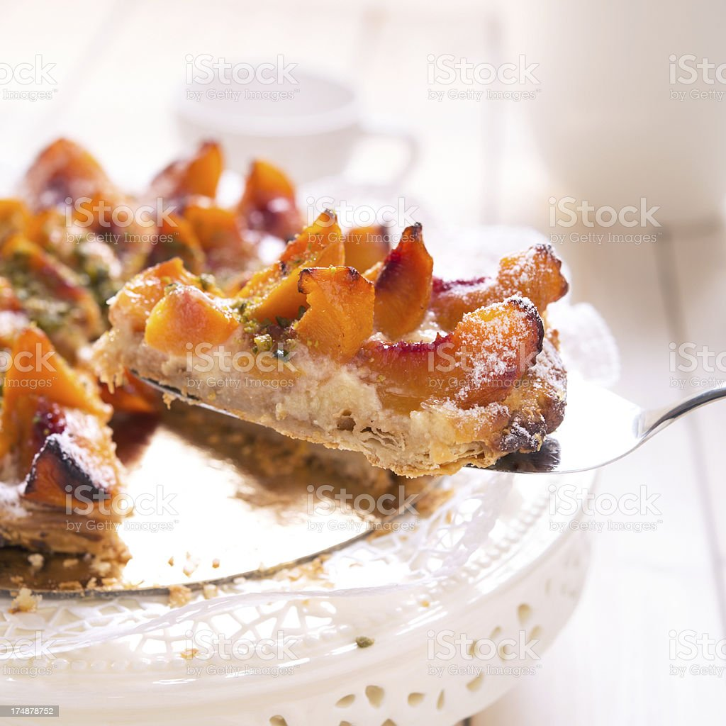 Fresh Peach Tart With Chopped Pistachio stock photo