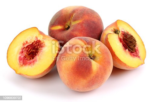 Fresh Peaches and halved isolated on white background