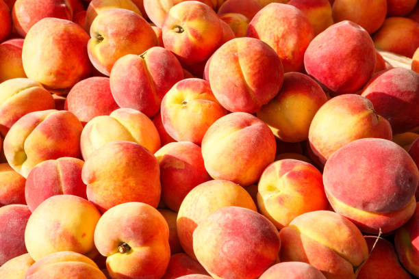 Fresh Peaches at an Outdoor Market stock photo
