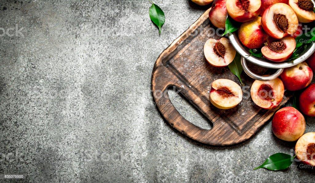Fresh peaches in a bowl. stock photo