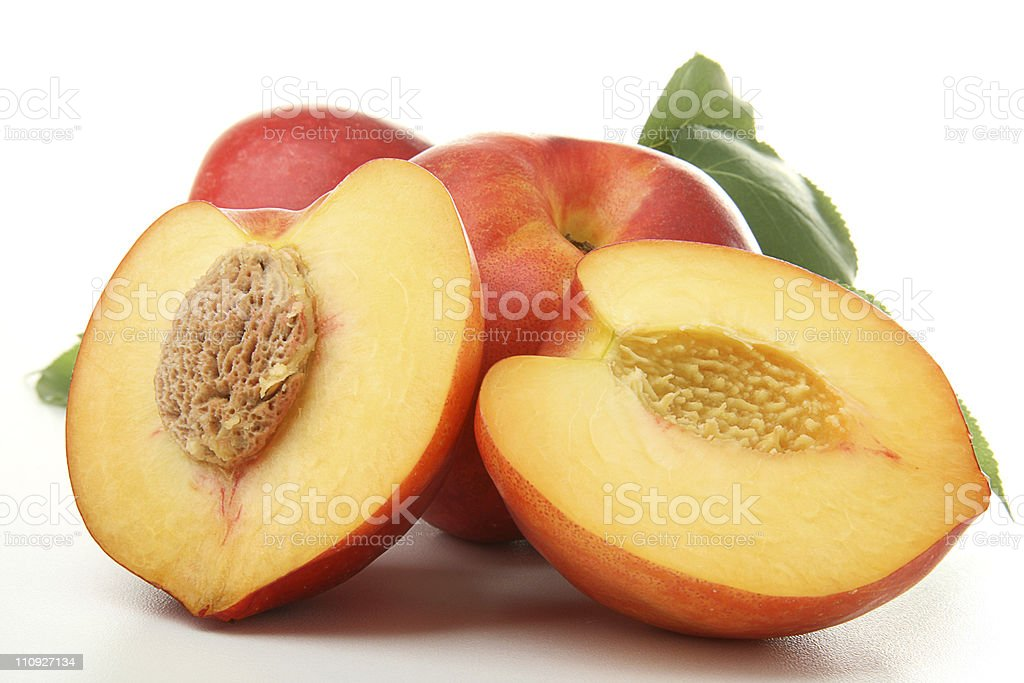 Fresh peaches isolated on a white background royalty-free stock photo