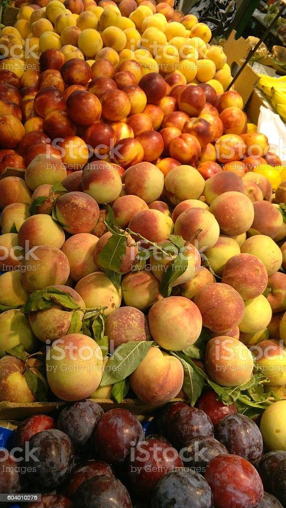 Fresh peaches on display stock photo