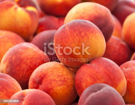 Heap of fresh organic peaches on display at a market.