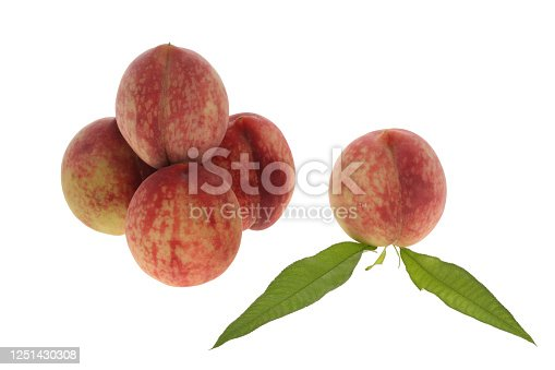 fresh peaches with leaves on white background