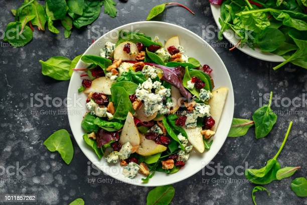 Photo of Fresh Pears, Blue Cheese salad with vegetable green mix, walnuts, cranberry. healthy food