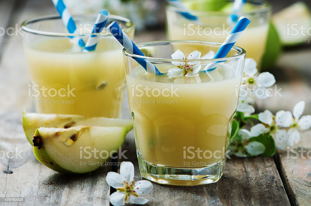 Fresh pears juice on the wooden table stock photo