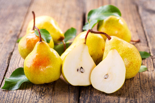 fresh pears with leaves stock photo