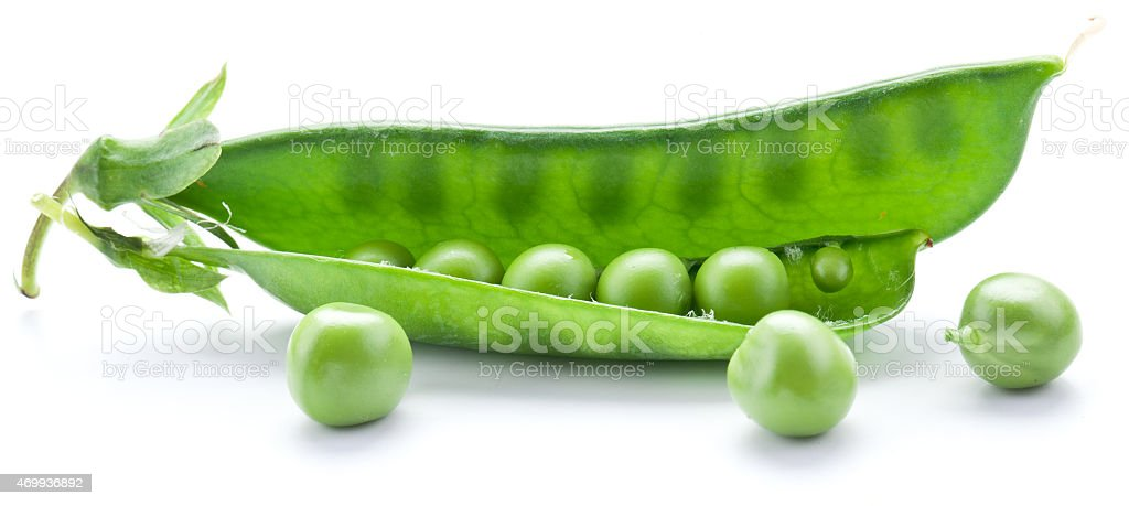 Fresh peas are contained within a pod. stock photo
