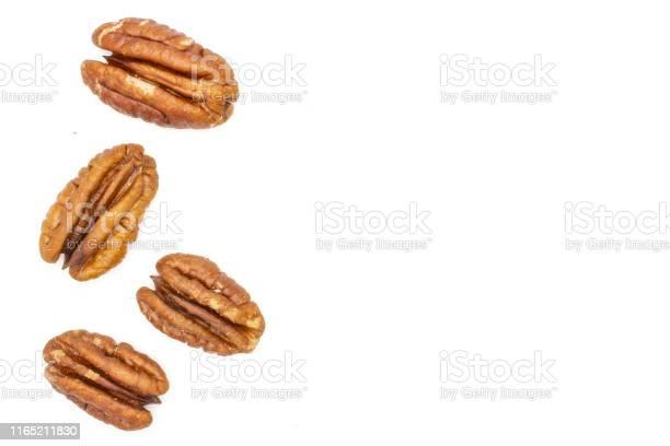 Fresh pecan nut isolated on white picture id1165211830?b=1&k=6&m=1165211830&s=612x612&h=iwayh2dos7qwl1pr 1dfgj8kmszkknj3bl7fbwvqgrw=