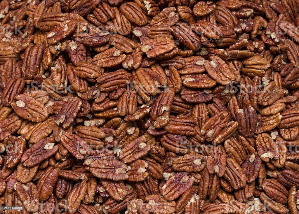 Fresh pecans bulk. pattern stock photo