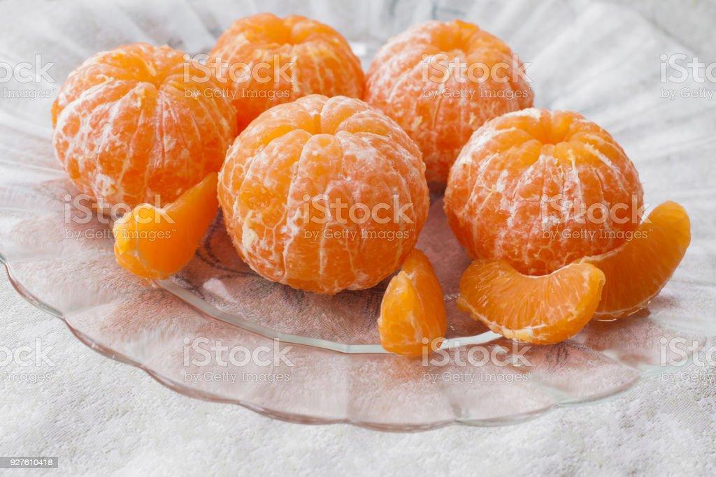 Fresh peeled tangerine stock photo