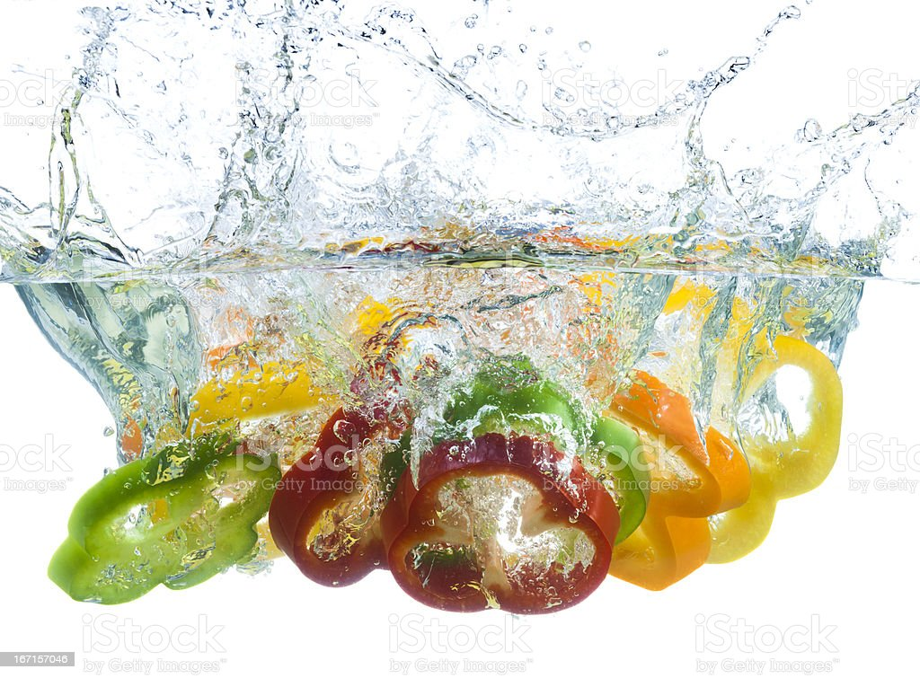 Fresh Pepper Slices Splash-Down in Cool Water royalty-free stock photo
