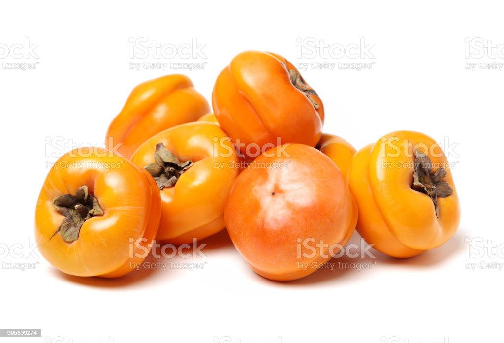 Fresh Persimmon fruits isolated on white background - Стоковые фото 2015 роялти-фри