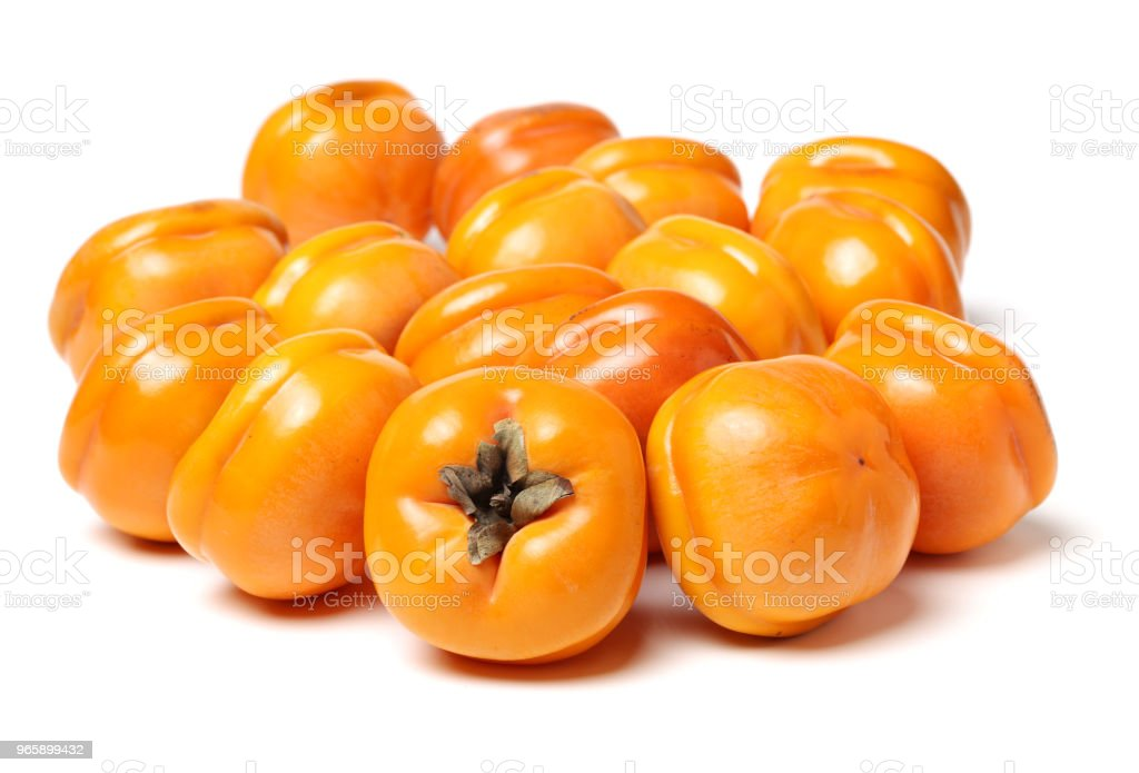 Fresh Persimmon fruits isolated on white background - Royalty-free 2015 Foto de stock