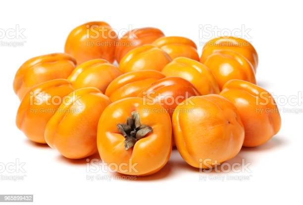 Fresh Persimmon Fruits Isolated On White Background - Fotografias de stock e mais imagens de 2015
