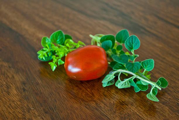 Fresh picked grape tomato and oregano stock photo