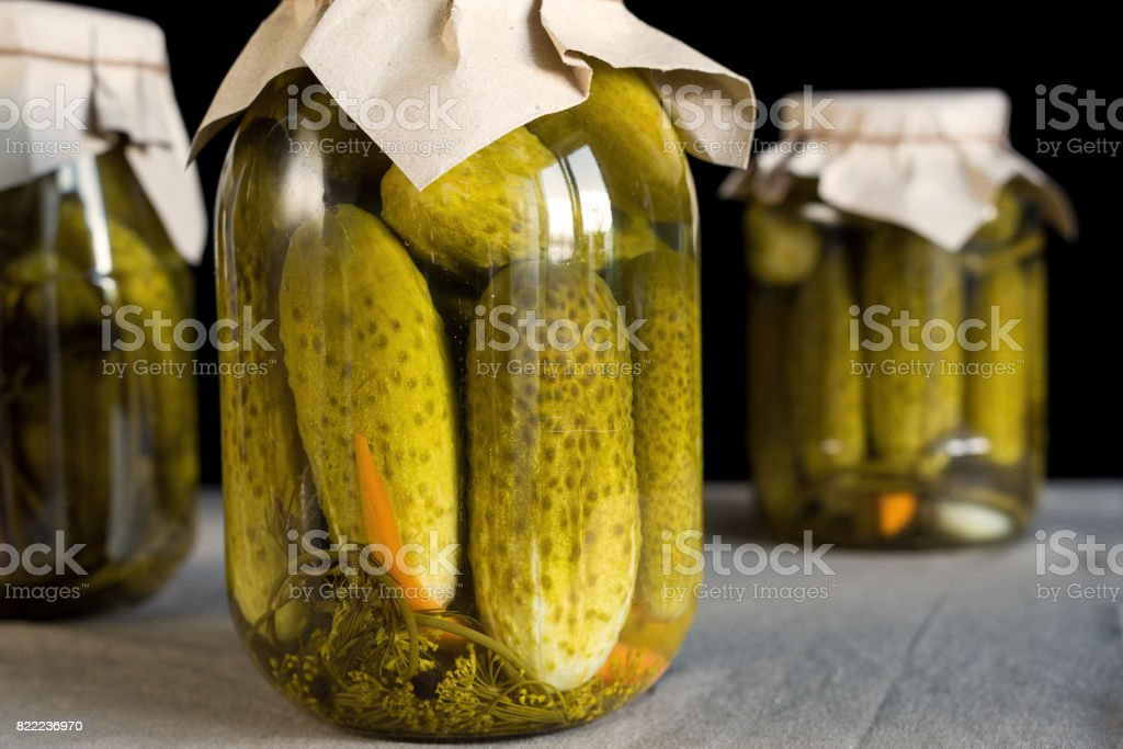 Fresh pickled cucumbers on black background, homemade preserved vegetables stock photo