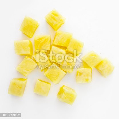 Fresh pineapple cube slices isolated on the white background. Pineapple chunks close up