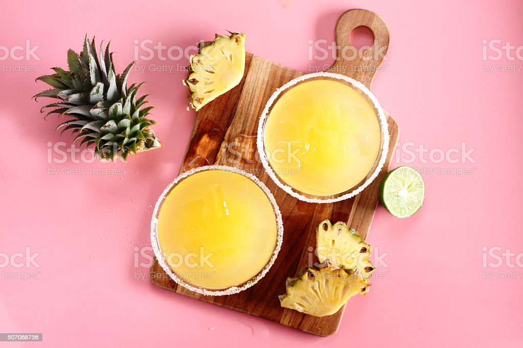 Fresh pineapple juice in the glass stock photo