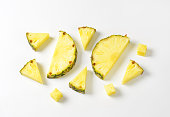 Fresh pineapple slices and wedges