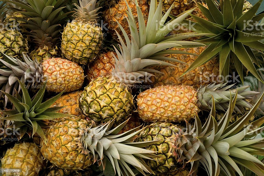 Fresh pineapples as a background royalty-free stock photo