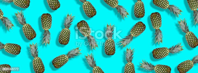 917861766istockphoto Fresh pineapples on the blue colorfurful background 968443272