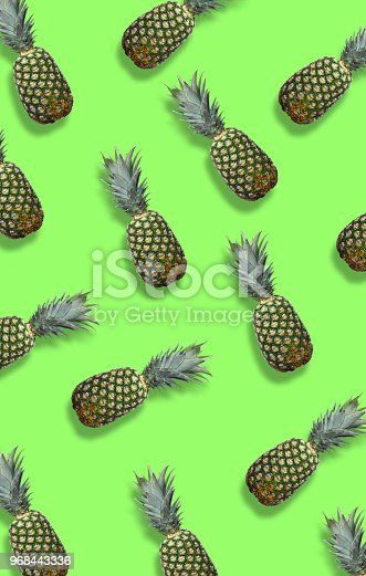 917861766istockphoto Fresh pineapples on the green colorfurful background 968443336