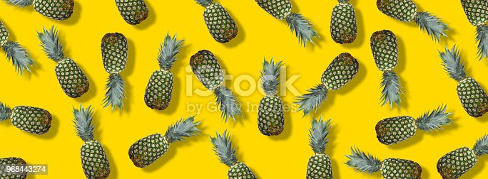 917861766istockphoto Fresh pineapples on the yellow colorfurful background 968443274
