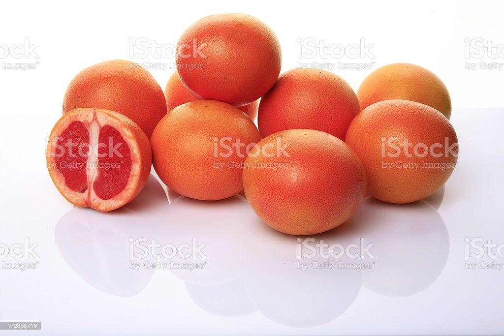 fresh pink grapefruits on white background royalty-free stock photo