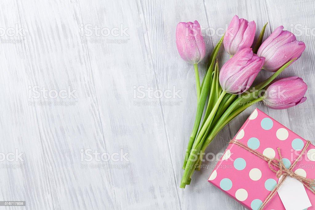 Fresh pink tulip flowers and gift box stock photo