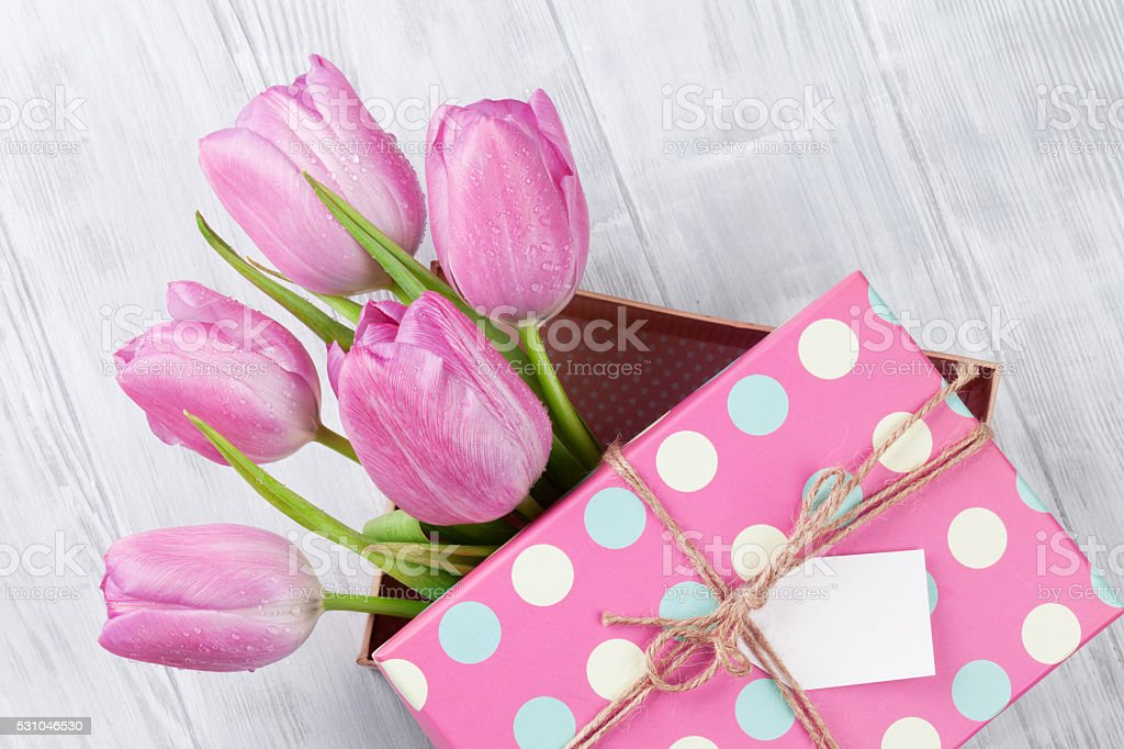 Fresh pink tulip flowers in gift box stock photo